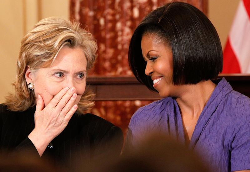 Hillary Rodham Clinton chats with first lady Michelle Obama