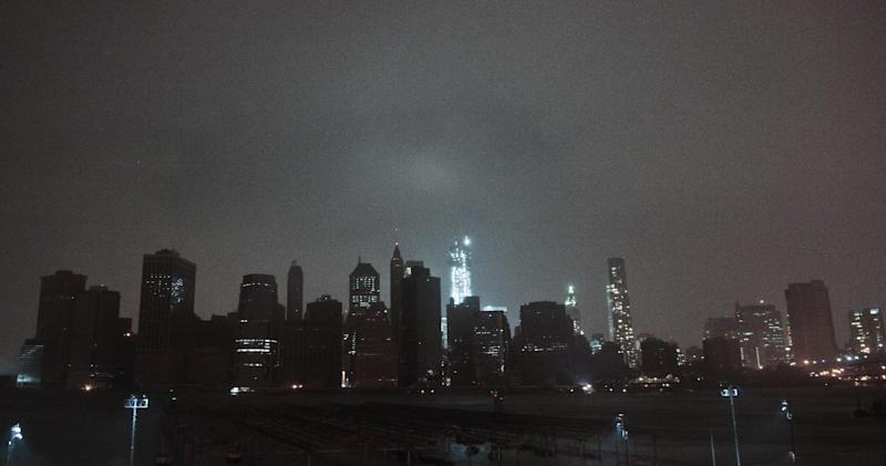 Lower Manhattan goes dark during the hybrid storm Sandy, on Monday, Oct. 29, 2012, viewed from the Brooklyn borough of New York. Authorities warned that New York City and Long Island could get the worst of the storm surge: an 11-foot onslaught of seawater that could swamp lower areas of the city. (AP Photo/Bebeto Matthews)