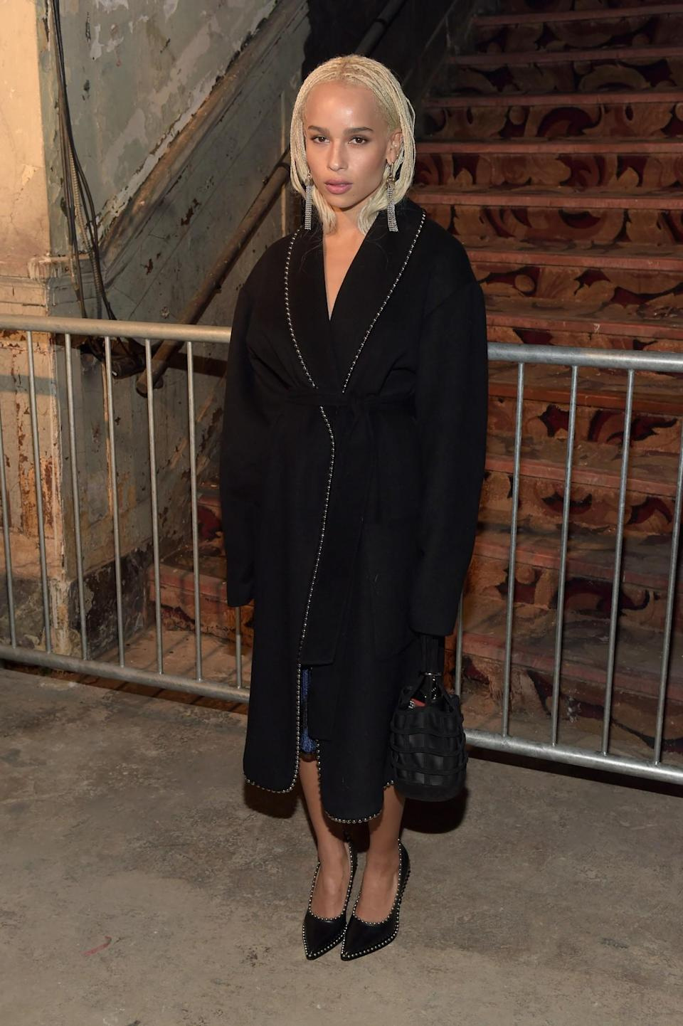 <p>Zoe Kravitz covered up in an elegant black coat and matching heels. <i>[Photo: Getty]</i> </p>