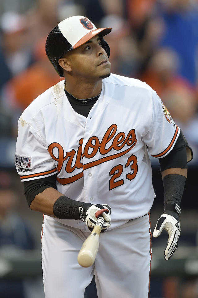Baltimore Orioles designated hitter Nelson Cruz (23) watches his two-run homer against the Detroit Tigers in the first inning during Game 1 of baseball's AL Division Series, Thursday, Oct. 2, 2014, in Baltimore. (AP Photo/Nick Wass)