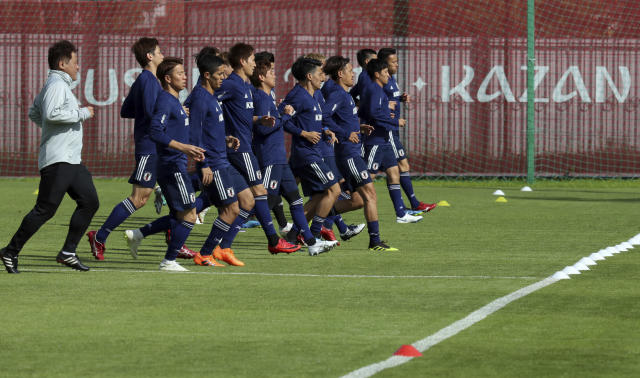 Players warm up during a training session of Japan national team at the 2018 soccer World Cup in Kazan, Russia, Friday, June 15, 2018. (AP Photo/Eugene Hoshiko)