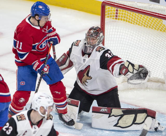 Arizona Coyotes goaltender Antti Raanta (32) makes a save against Montreal Canadiens right wing Brendan Gallagher (11) during second-period NHL hockey game action, Monday, Feb. 10, 2020, in Montreal. (Ryan Remiorz/The Canadian Press via AP)