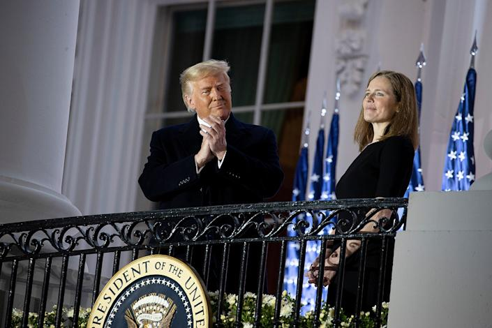 Trump stands with Amy Coney Barrett during a ceremonial swearing-in event (Getty Images)