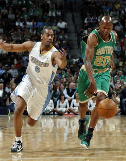 Boston Celtics guard Ray Allen, right, chases down the loose ball as Denver Nuggets guard Arron Afflalo chases in the first quarter of an NBA basketball game in Denver on Saturday, March 17, 2012. (AP Photo/David Zalubowski)