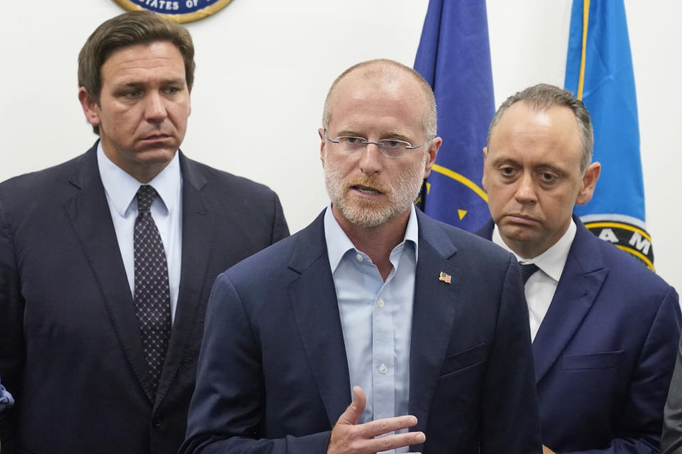 Brendan Carr, center, commissioner of the Federal Communications Commission, speaks during a news conference at the offices of Rep. Maria Elvira Salazar, R-Fla., alongside Florida Gov. Ron DeSantis, left, and Marcell Felipe, right, founder of the Inspire America Foundation, an organization dedicated to promoting democracy in Cuba and the Americas, Thursday, July 15, 2021, in Miami. DeSantis and other officials pressed the White House on Thursday to support efforts to preserve internet service to antigovernment protesters in Cuba, even advocating the use of giant balloons as floating Wi-Fi hotspots to allow images of dissent to stream unabated from the authoritarian nation. (AP Photo/Wilfredo Lee)