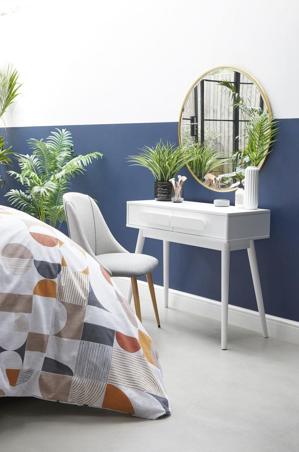 <p>In crisp white, this dressing table helps to create the illusion of a bigger space – and it's right at the top of our wish list. </p><p>'Perfect for small spaces and minimalist aesthetics, the Anders dressing table perfectly pays homage to mid-century Scandi design,' say Dunelm. </p>