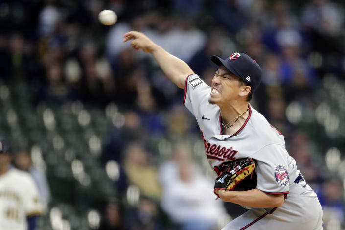 Minnesota Twins' Kenta Maeda pitches during the first inning of an Opening Day baseball game against the Milwaukee Brewers Thursday, April 1, 2021, in Milwaukee. (AP Photo/Aaron Gash)