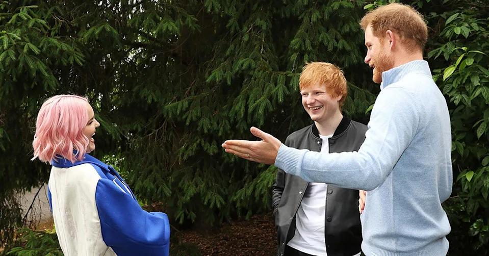 Prince Harry talking with Ed Sheeran and Anne-Marie.