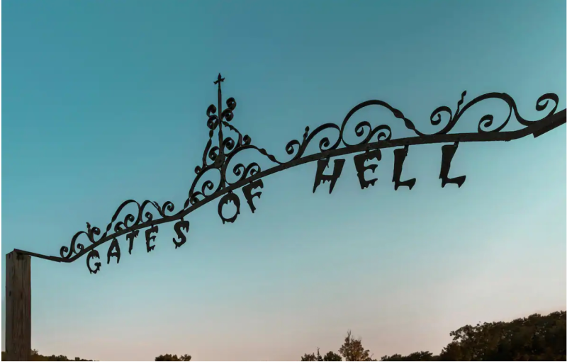 The gates of hell, which welcome you to the property. (Photo: Airbnb)