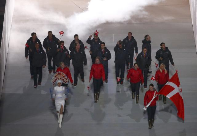 Denmark's flag-bearer Lene Nielsen (front R) holds the national flag as she leads the contingent in the athletes parade during the opening ceremony for the 2014 Sochi Winter Olympics February 7, 2014. REUTERS/David Gray (RUSSIA - Tags: OLYMPICS SPORT)