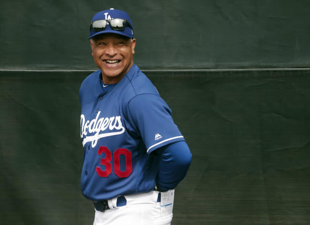 FILE - In this Feb. 13, 2019, file photo, Los Angeles Dodgers manager Dave Roberts smiles during a spring training baseball workout in Glendale, Ariz. The Dodgers boast quality and depth in their pitching ranks. (AP Photo/Morry Gash, File)