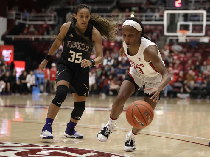 Stanford's Kiana Williams, right, and Washington's Alexis Griggsby (35) chase the ball in the second half of an NCAA college basketball game Sunday, Jan. 5, 2020, in Stanford, Calif. (AP Photo/Ben Margot)