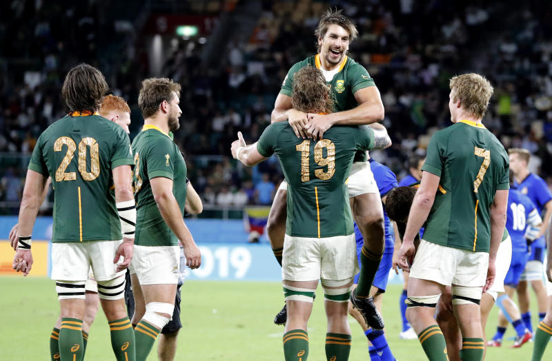 South Africa's Eben Etzebeth celebrates with teammate RG Snyman following their Rugby World Cup Pool B game at Shizuoka Stadium Ecopa against Italy in Shizuoka, Japan, Friday, Oct. 4, 2019. South Africa defeated Italy 49-3. (AP Photo/Shuji Kajiyama)