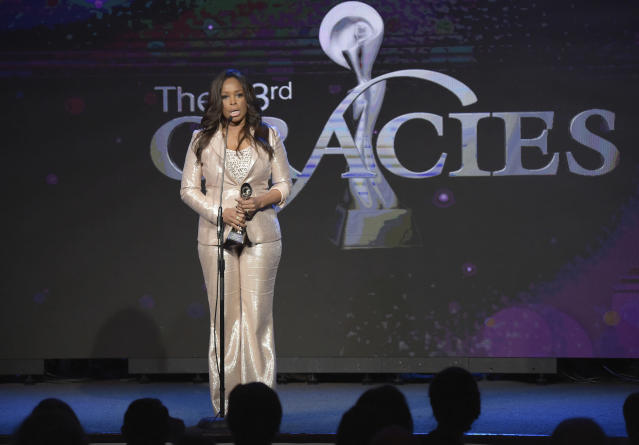 Pam Oliver accepts a Gracie Award in 2018. (Photo by Richard Shotwell/Invision/AP)