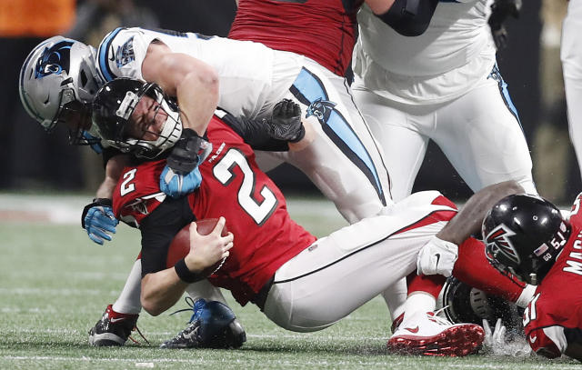 <p>Carolina Panthers middle linebacker Luke Kuechly (59) sacks Atlanta Falcons quarterback Matt Ryan (2) during the second half of an NFL football game, Sunday, Dec. 31, 2017, in Atlanta. (AP Photo/David Goldman) </p>