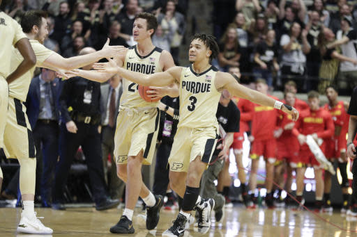 Purdue forward Grady Eifert (24) and guard Carsen Edwards (3) celebrate as they come off the court following an NCAA college basketball game against Maryland in West Lafayette, Ind., Thursday, Dec. 6, 2018. Purdue defeated Maryland 62-60. (AP Photo/Michael Conroy)