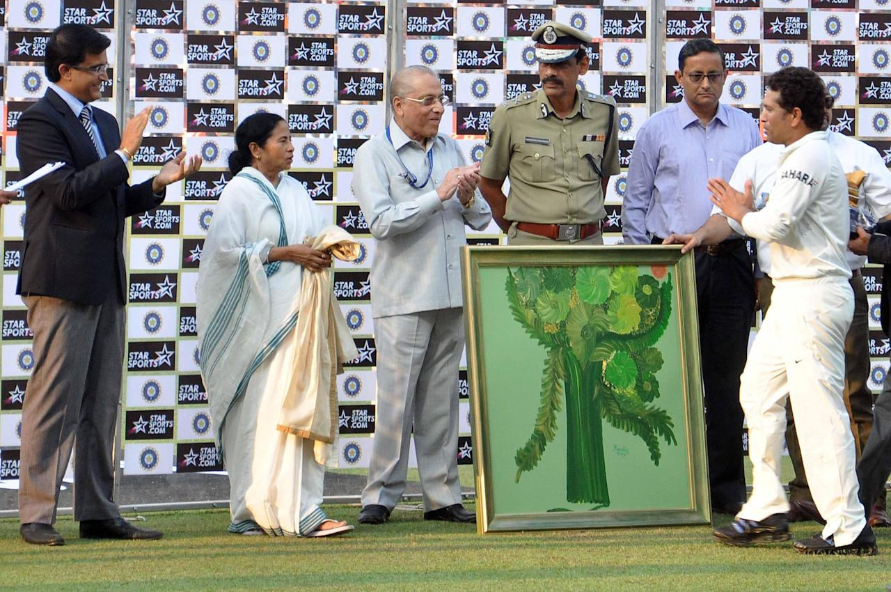 West Bengal Chief Minister Mamata Banerjee, former BCCI President Jagmohan Dalmiya former cricketer Sourav Ganguly and Kolkata Police Commissioner Surajit Kar Purkayastha during felecitation ceremony of master blaster Sachin Tendulkar as India won 1st test match between India and West Indies at Eden Gardens, Kolkata on Nov. 8, 2013. (Photo: IANS)