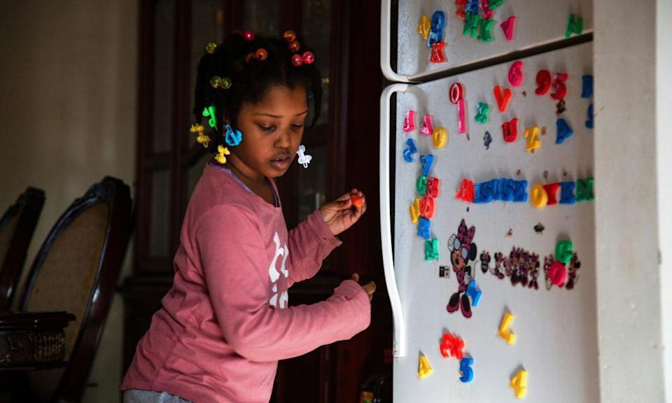 Lilliana prepares to start classes at home while her school was closed due to coronavirus restrictions in Louisville, Kentucky, in February.