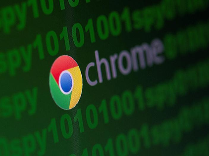"FILE PHOTO: Google Chrome logo is seen near cyber code and words ""spy""  in this illustration picture taken June 18, 2020. REUTERS/Dado Ruvic/Illustration"