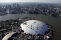 An aerial view shows the North Greenwich Arena with Canary Wharf in the background in London, March 27, 2012. London will host this summer's Olympic Games. REUTERS/Stefan Wermuth