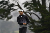 Li Haotong of China, watches his tee shot on the fourth hole during the third round of the PGA Championship golf tournament at TPC Harding Park Saturday, Aug. 8, 2020, in San Francisco. (AP Photo/Jeff Chiu)