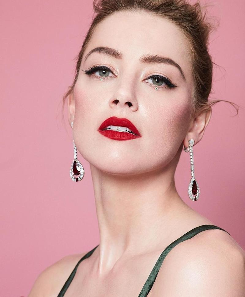 Amber Heard shows off a bold red lip. Photo courtesy of Instagram.