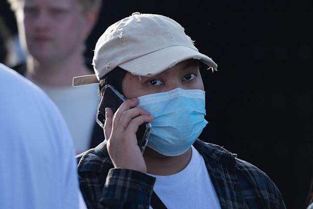 A man is pictured wearing a face mask in Wellington on 14 February, despite New Zealand having no confirmed cases. (Getty Images)