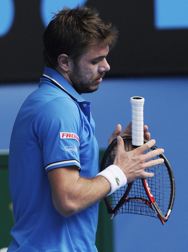 FILE- In this Jan. 25, 2011 file photo, Switzerland's Stanislas Wawrinka folds his smashed racket during his quarterfinal match against compatriot Roger Federer at the Australian Open tennis championships in Melbourne, Australia. Happens all the time in top-level tennis, in fact: a public tantrum by a pro that can reveal frustration, sometimes reverses the course of a contest, usually results in a fine of thousands of dollars and even - as was the case with Serena Williams in last year's U.S. Open final - cost a player a point. (AP Photo/Andrew Brownbill, File)