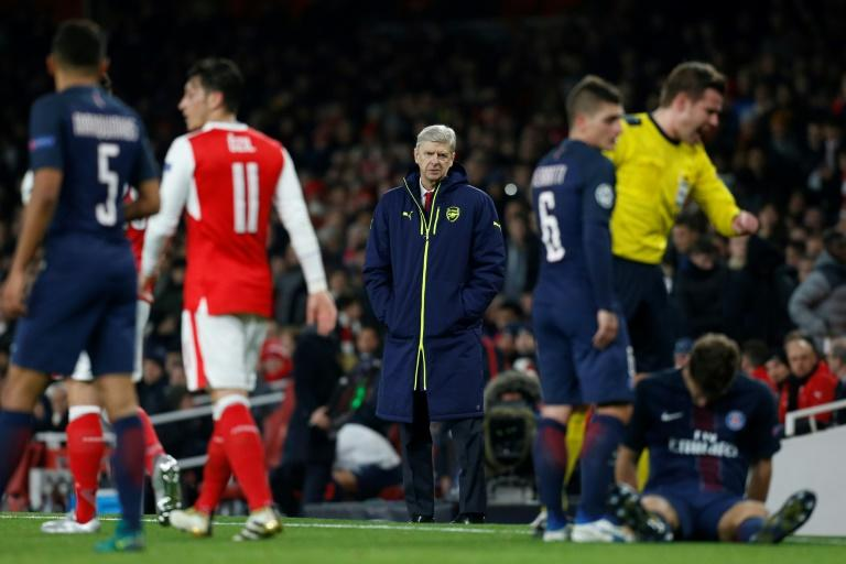 Arsenal's manager Arsene Wenger (C) watches from the touchline during the UEFA Champions League group match against Paris Saint-Germain, at the Emirates Stadium in London, in November 2016