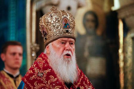 Patriarch Filaret, head of the Ukrainian Orthodox Church of the Kiev Patriarchate, addresses believers as he conducts a service at the Volodymysky Cathedral in Kiev, Ukraine October 11, 2018. REUTERS/Valentyn Ogirenko