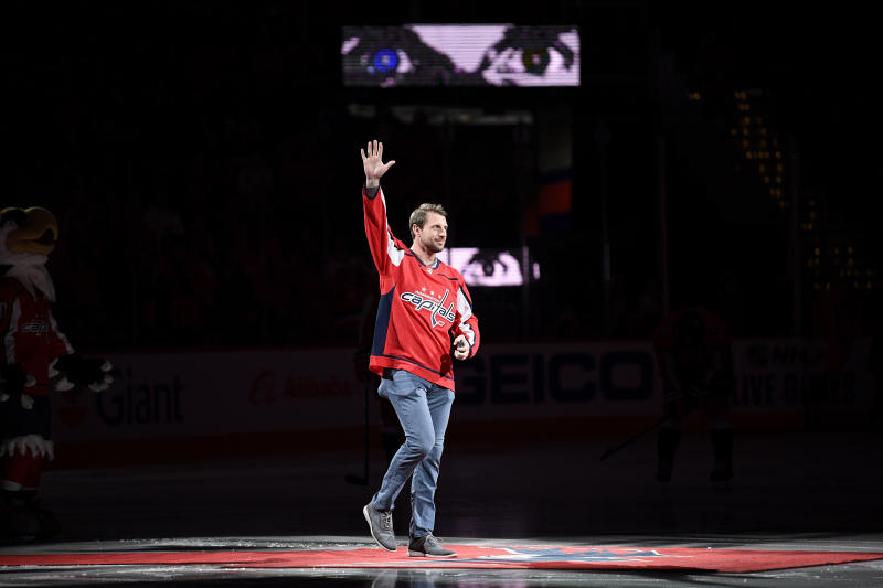 Washington Nationals baseball player Max Scherzer waves to the crowd before a ceremonial puck drop before an NHL hockey game between the Washington Capitals and the New York Rangers, Friday, Oct. 18, 2019, in Washington. Scherzer substituted a baseball for a puck. (AP Photo/Nick Wass)