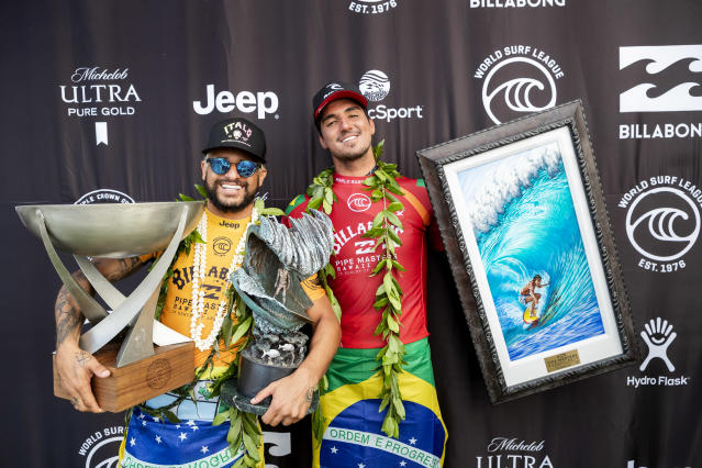 OAHU, HAWAII - DECEMBER 19: (L-R) Italo Ferreira of Brazil winner of his maiden WSL World Title and his maiden 2019 Billabong Pipe Masters and Two-time WSL Champion Gabriel Medina of Brazil runner-up at Pipeline on December 19, 2019 in Oahu, United States. (Photo by Kelly Cestari/WSL via Getty Images)