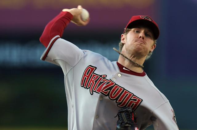 Arizona Diamondbacks starting pitcher Chase Anderson works against the Colorado Rockies in the first inning of a baseball game in Denver on Tuesday, June 3, 2014. (AP Photo/David Zalubowski)