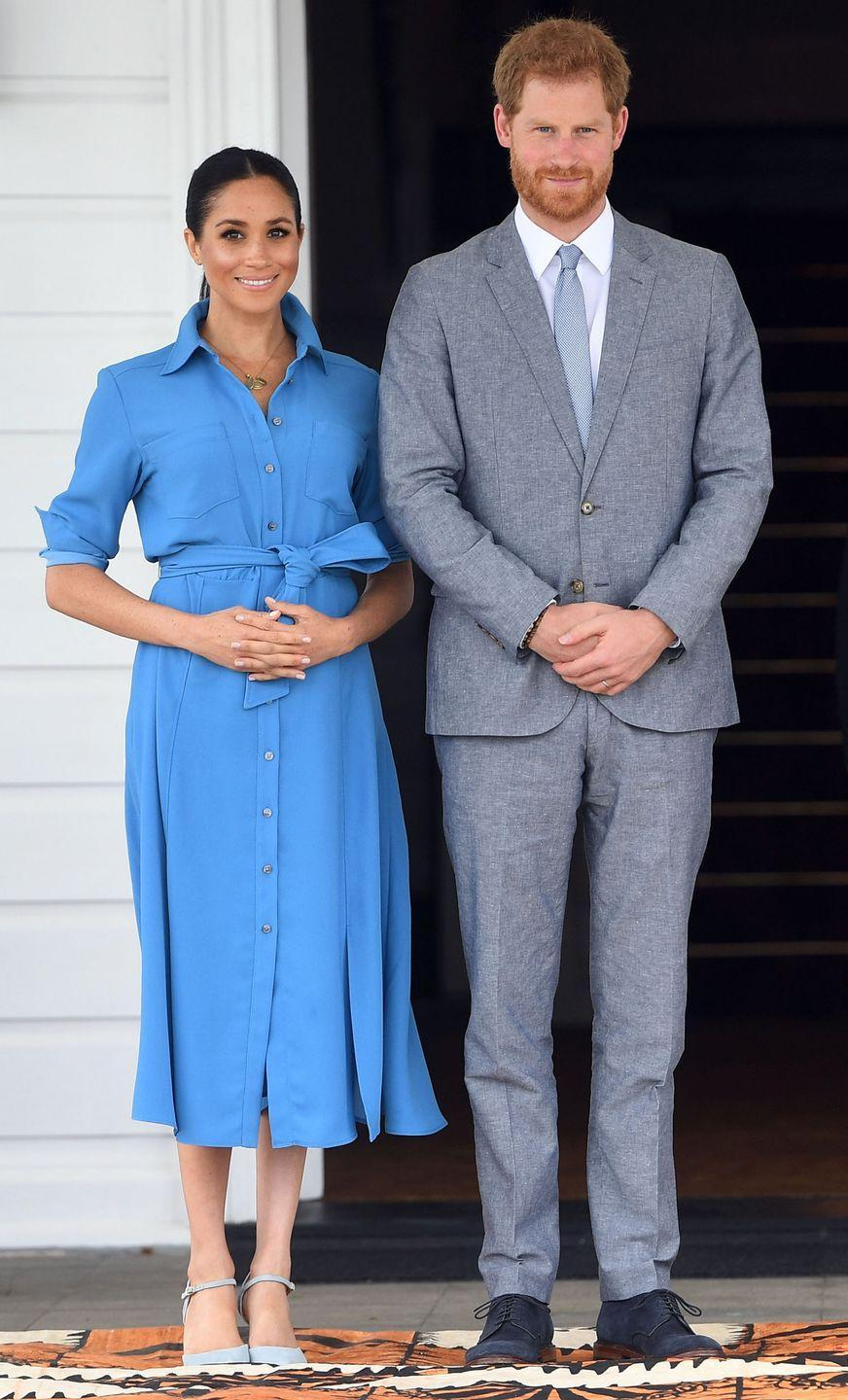 """<p>The Duchess changed for her afternoon engagements into a blue dress by Veronica Beard paired with blue heels by Banana Republic.</p><p><a class=""""link rapid-noclick-resp"""" href=""""https://go.redirectingat.com?id=74968X1596630&url=https%3A%2F%2Fbananarepublic.gap.com%2Fbrowse%2Fproduct.do%3Fvid%3D1%26pid%3D323475012%26searchText%3DMadison%2B12-Hour%2BSide%2BCut-Out%2BPump&sref=https%3A%2F%2Fwww.townandcountrymag.com%2Fstyle%2Ffashion-trends%2Fg3272%2Fmeghan-markle-preppy-style%2F"""" rel=""""nofollow noopener"""" target=""""_blank"""" data-ylk=""""slk:SHOP NOW"""">SHOP NOW</a> <em>Madison 12-Hour Side Cut-Out Pump, $89.50</em></p>"""