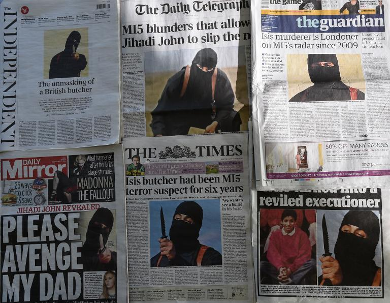 """An arrangment of British daily newspapers photographed in London on February 27, 2015 shows the front-page headlines and stories regarding the identification of the masked Islamic State group militant dubbed """"Jihadi John"""""""