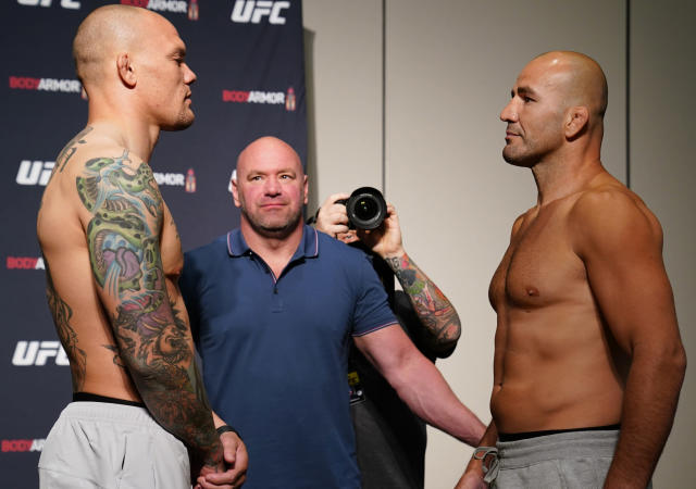 JACKSONVILLE, FLORIDA - MAY 12: (L-R) Opponents Anthony Smith and Glover Teixeira of Brazil face off during the official UFC Fight Night weigh-in on May 12, 2020 in Jacksonville, Florida. (Photo by Cooper Neill/Zuffa LLC via Getty Images)