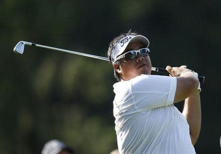 Thailand's Kiradech Aphibarnrat tees off on the 11th hole during the first round of the 2013 PGA Championship golf tournament at Oak Hill Country Club in Rochester, New York August 8, 2013. REUTERS/Mathieu Belanger