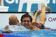 LONDON, ENGLAND - AUGUST 01: Nathan Adrian (R) of the United States is congratulated by Brent Hayden of Canada after Adrian won the Final of the Men's 100m Freestyle on Day 5 of the London 2012 Olympic Games at the Aquatics Centre on August 1, 2012 in London, England. (Photo by Clive Rose/Getty Images)