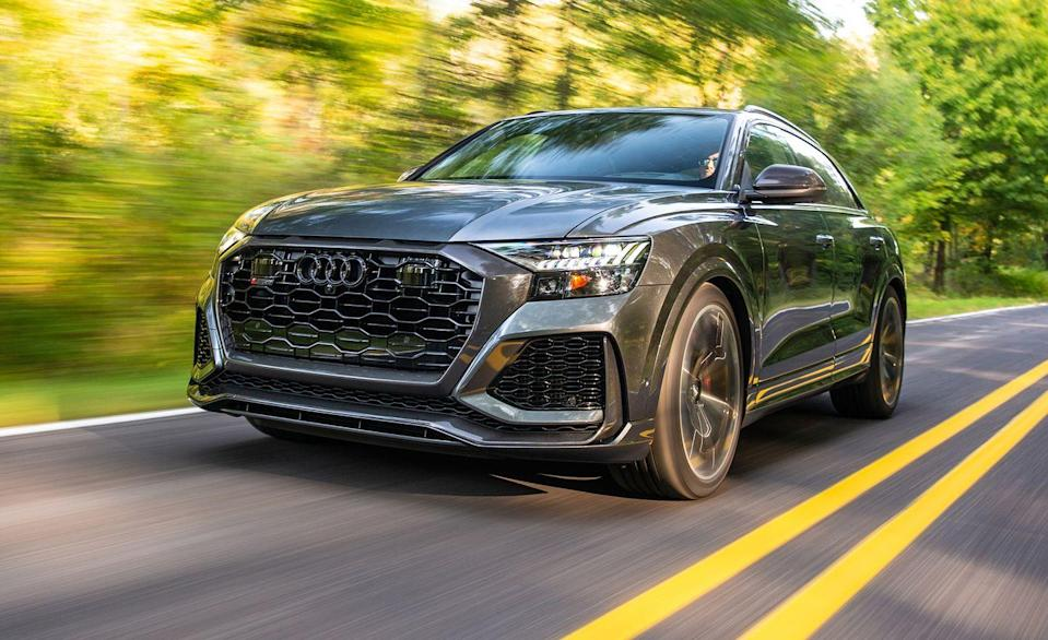 """<p>The <a href=""""https://www.caranddriver.com/audi/rs-q8"""" rel=""""nofollow noopener"""" target=""""_blank"""" data-ylk=""""slk:Audi RS Q8"""" class=""""link rapid-noclick-resp"""">Audi RS Q8</a> uses a twin-turbocharged 4.0-liter V-8 with 590 lb-ft of torque. Quattro all-wheel drive and an eight-speed automatic transmission are standard too. Audi claims the high-power Q8 can get to 60 mph in 3.7 seconds but we did it in just 3.2, trailing the more powerful Lamborghini Urus by just a tenth. It's not just a straight-liner, either. It lapped the <a href=""""https://www.caranddriver.com/news/a29711782/audi-rs-q8-nurburgring-record/"""" rel=""""nofollow noopener"""" target=""""_blank"""" data-ylk=""""slk:Nürburgring in 7:42 in 2019"""" class=""""link rapid-noclick-resp"""">Nürburgring in 7:42 in 2019</a>, a record for the fastest SUV around the Green Hell that it still holds today. Audi says the RS Q8 has a top speed of 190 mph and is available with wide 295/35R-23 tires to keep it stuck to the tarmac. It starts at $115,595, which is about $15,000 less than the 541-hp <a href=""""https://www.caranddriver.com/porsche/cayenne-turbo-turbo-s"""" rel=""""nofollow noopener"""" target=""""_blank"""" data-ylk=""""slk:Porsche Cayenne Turbo"""" class=""""link rapid-noclick-resp"""">Porsche Cayenne Turbo</a> and $106,409 cheaper than the Urus.</p><p><a class=""""link rapid-noclick-resp"""" href=""""https://www.caranddriver.com/audi/rs-q8/specs"""" rel=""""nofollow noopener"""" target=""""_blank"""" data-ylk=""""slk:MORE RS Q8 SPECS"""">MORE RS Q8 SPECS</a></p>"""