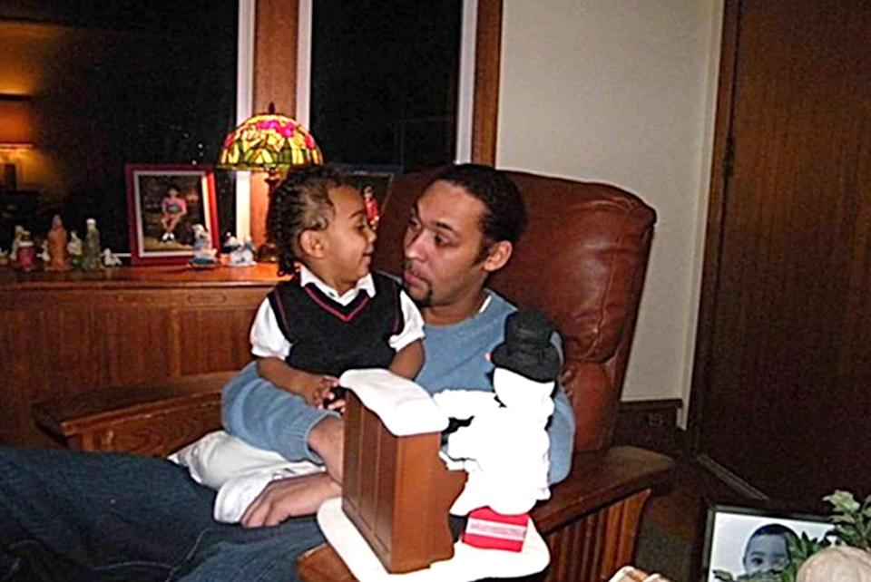Leonard Thomas with his son. Leonard Thomas, a 30-year-old father, was killed by police during a 2013 standoff at his Fife home. (Family photo)