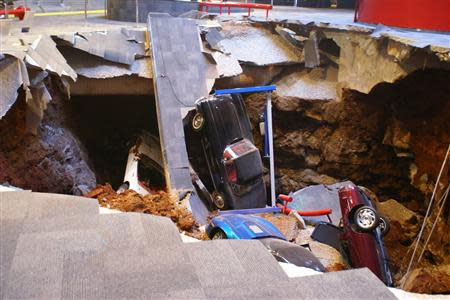 National Corvette Museum handout photo shows a 40-foot sinkhole that opened up under the Museum February 12, 2014 and swallowed eight Corvettes, including the historic 1992 White 1 Millionth Corvette, in Bowling Green, Kentucky. REUTERS/National Corvette Museum/Handout via Reuters