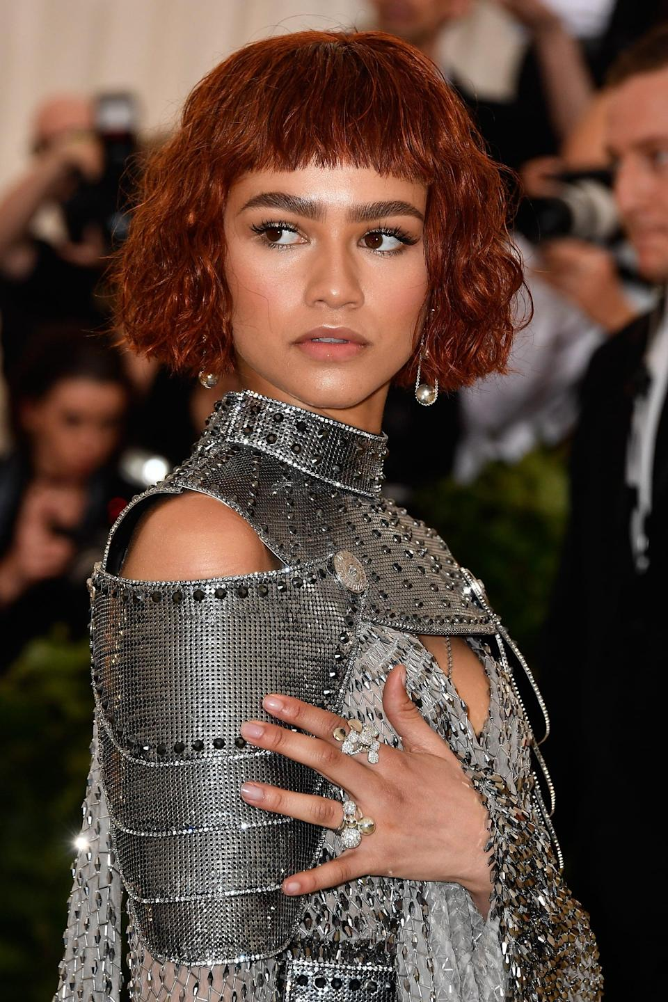 "<p><a href=""https://www.popsugar.com/fashion/Zendaya-Met-Gala-Dress-2018-44821237"" class=""link rapid-noclick-resp"" rel=""nofollow noopener"" target=""_blank"" data-ylk=""slk:Zendaya was almost unrecognizable at the 2018 Met Gala"">Zendaya was almost unrecognizable at the 2018 Met Gala</a> with her wavy Joan of Arc-inspired blunt red bob and short bangs. </p>"