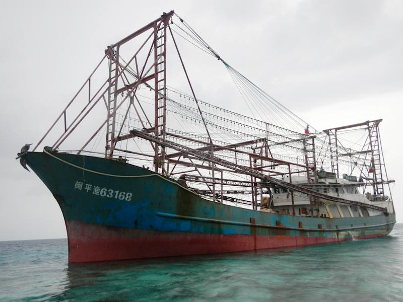 Philippines charges crew of ship that rammed reef