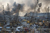 Smoke rises in the aftermath of a massive explosion in Beirut, Lebanon, Tuesday, Aug. 4, 2020. (AP Photo/Hassan Ammar)