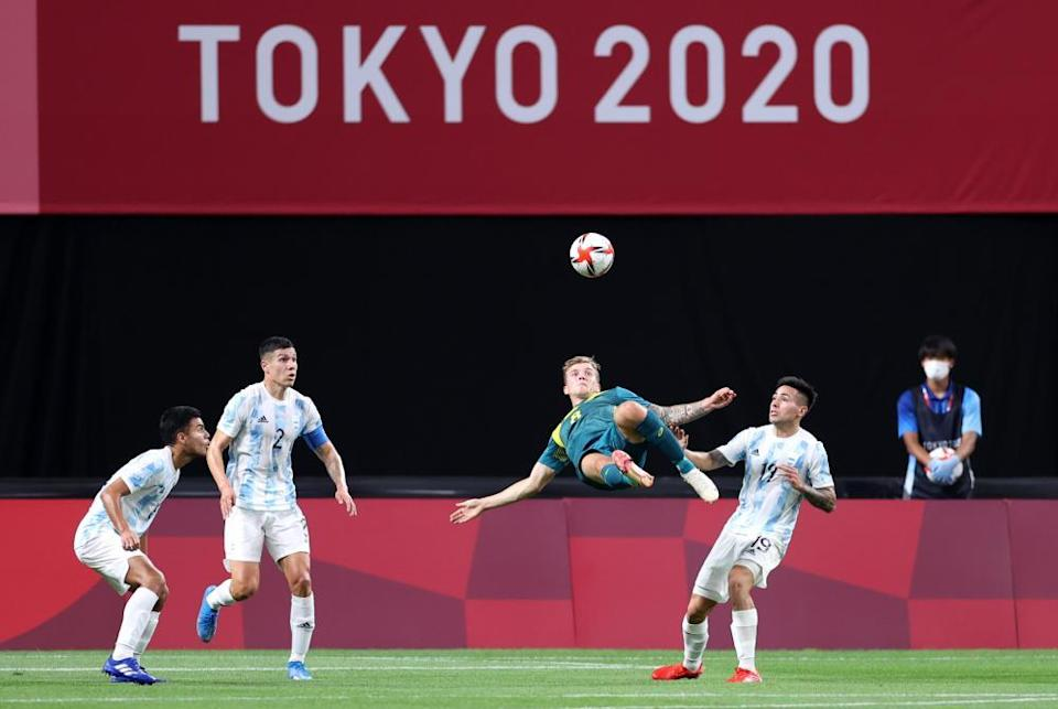 Australia's Riley McGree tries to score with an overhead kick against Argentina.