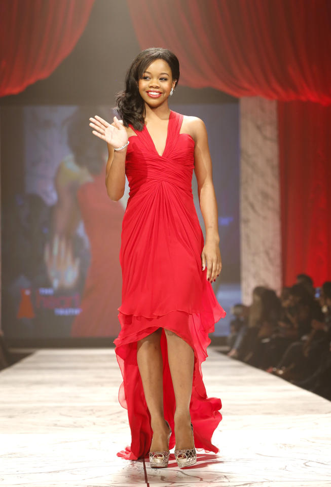 Gabby Douglas walks the runway at the Red Dress Collection 2013 Fashion Show, on Wednesday, Feb. 6, 2013 in New York. (Photo by John Minchillo/Invision/AP)