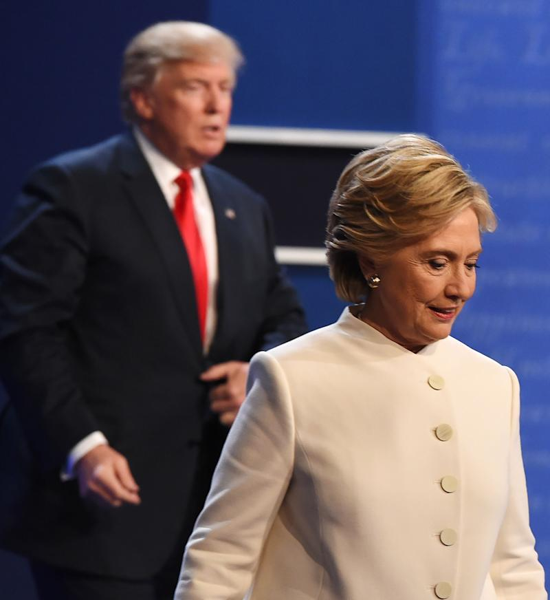 Democratic nominee Hillary Clinton (R) and Republican nominee Donald Trump walk off the stage after the final presidential debate at the Thomas & Mack Center on the campus of the University of Las Vegas in Las Vegas, Nevada on October 19, 2016. / AFP / Robyn Beck (Photo credit should read ROBYN BECK/AFP/Getty Images)