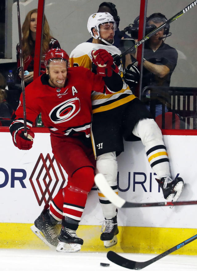 Carolina Hurricanes' Jordan Staal, left, collides with Pittsburgh Penguins' Brian Dumoulin, right, during the first period of an NHL hockey game, Saturday, Dec. 22, 2018, in Raleigh, N.C. (AP Photo/Karl B DeBlaker)