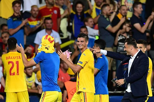 Sharing the spoils: A goalless draw sent both Romania and France through ot the European U21 Championships semi-finals (AFP Photo/Miguel MEDINA)