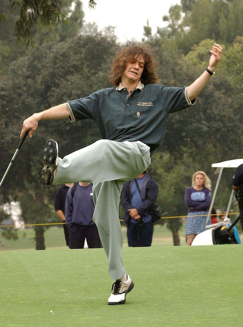 <p>Eddie Van Halen reacts to a putt during the 31st Annual Police-Celebrity Golf Tournament in 2002.</p>